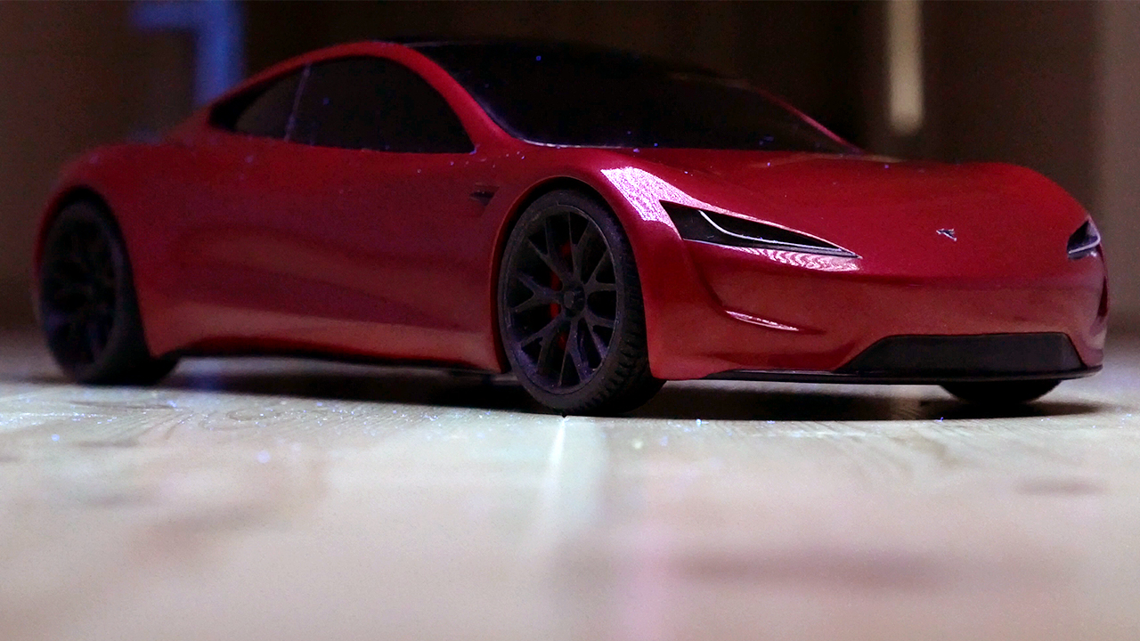 A finished scale model of a Tesla Roadster
